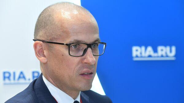 Глава Удмуртии Александр Бречалов во время интервью на стенде МИА Россия сегодня на Петербургском международном экономическом форуме-2019