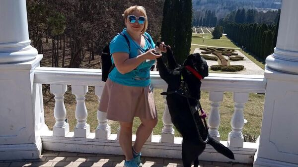 Оксана и ее собака-поводырь