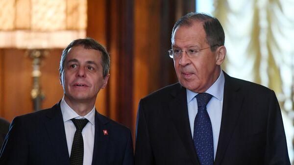 Министр иностранных дел РФ Сергей Лавров и министр иностранных дел Швейцарии Игнацио Кассис (слева) во время встречи в Доме приемов МИД России.