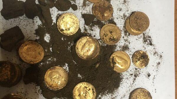 Клад монет времен Николая II, найденный в Москве