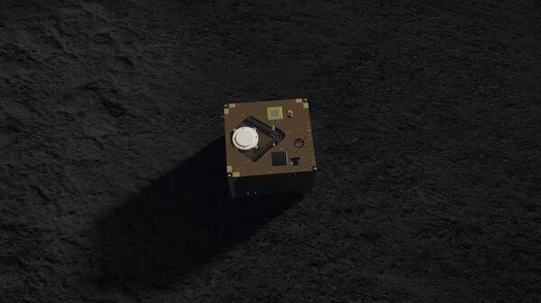 Так художник представил себе астероидный ровер MASCOT на поверхности астероида Рюгю