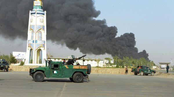 Дым над местом взрыва в Кандагаре. 18 июля 2019