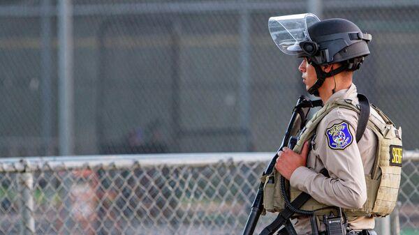 Сотрудник полиции на месте стрельбы в городе Гилрой, штат Калифорния, США. 28 июля 2019