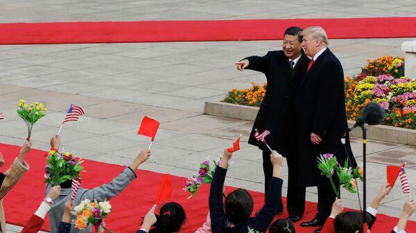 Председатель КНР Си Цзиньпин и президент США Дональд Трамп в Пекине