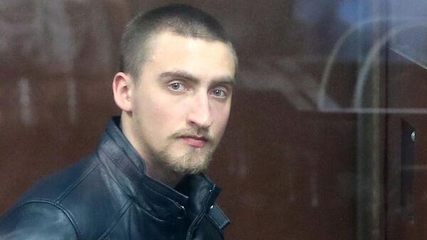 Павел Устинов, обвиняемый в нападении на бойца ОМОН в ходе несанкционированной акции протеста 3 августа, во время оглашения приговора в зале заседаний Тверского суда Москвы