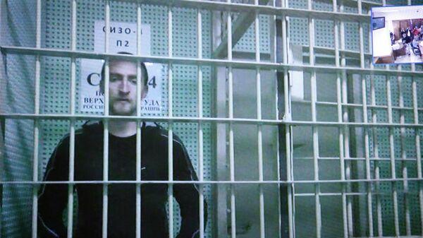 Актер Павел Устинов во время конференц-связи с Мосгорсудом