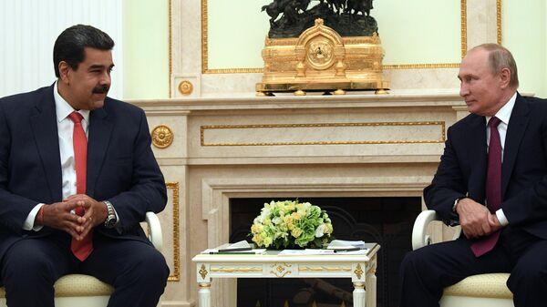 Президент РФ Владимир Путин и президент Венесуэлы Николас Мадуро во время встречи.