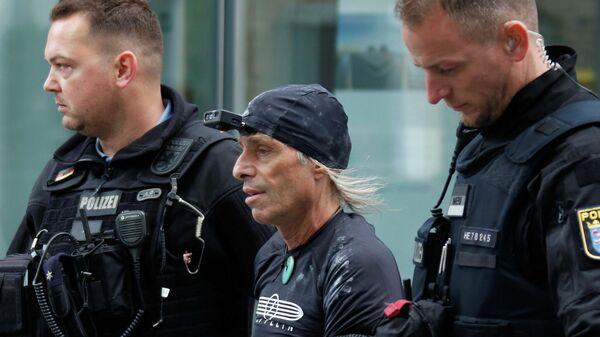 Ален Робер, задержан немецкой полицией после того, как он забрался на высотное здание в Франкфурте-на-Майне. 28 сентября 2019