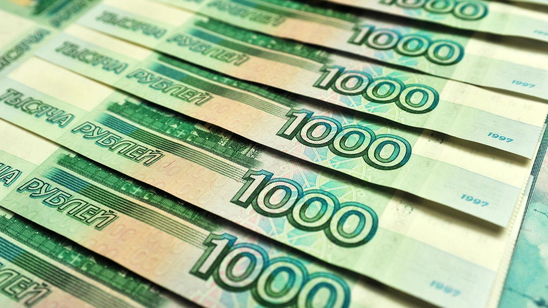 Банкноты номиналом 1000 рублей - РИА Новости, 1920, 06.09.2020