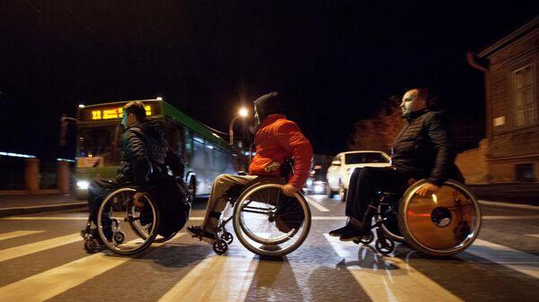Игроки команды Триумф возвращаются в гостиницу после матча всероссийского турнира по баскетболу на колясках в Тюмени