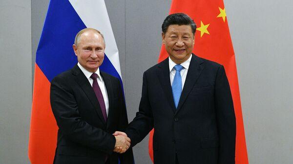 Путин поздравил Си Цзиньпина с годовщиной образования КНР