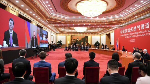 Церемония начала поставок российского газа в КНР по восточному маршруту в режиме видеомоста в Пекине
