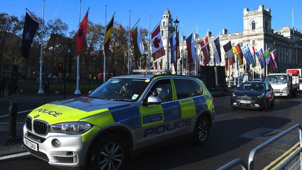 Полицейская машина в Лондоне в преддверии саммита НАТО