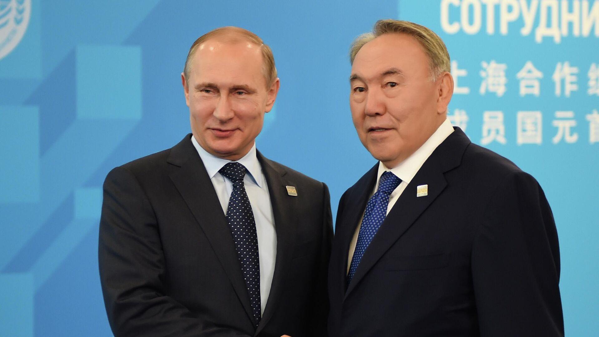 Президент РФ Владимир Путин и первый президент Республики Казахстан Нурсултан Назарбаев - РИА Новости, 1920, 29.06.2021
