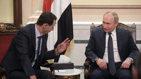 Президент РФ Владимир Путин и президент Сирии Башар Асад во время встречи в Дамаске