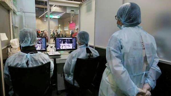 Тепловые сканеры на станции мониторинга температуры в Макао, Китай