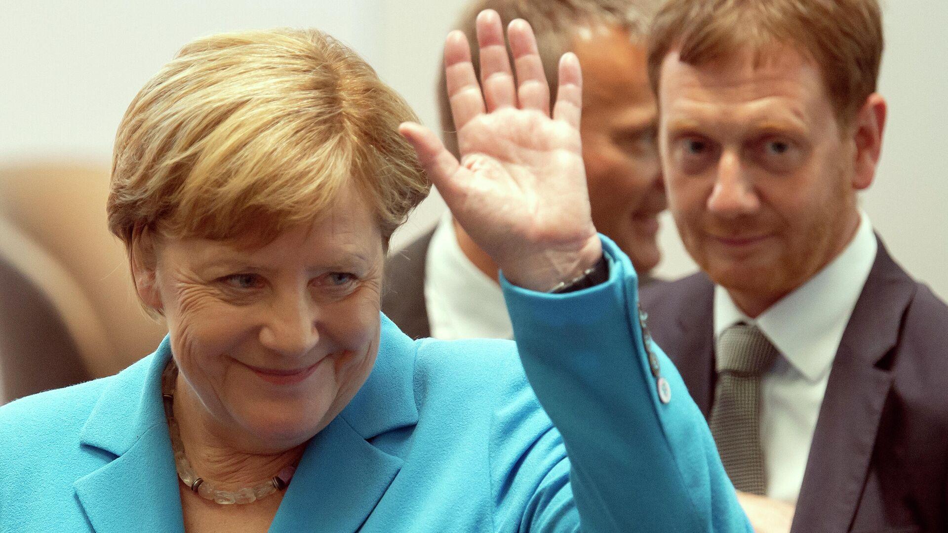 Канцлер Германии Ангела Меркель и премьер-министр Саксонии Михаэль Кречмер - РИА Новости, 1920, 29.09.2021
