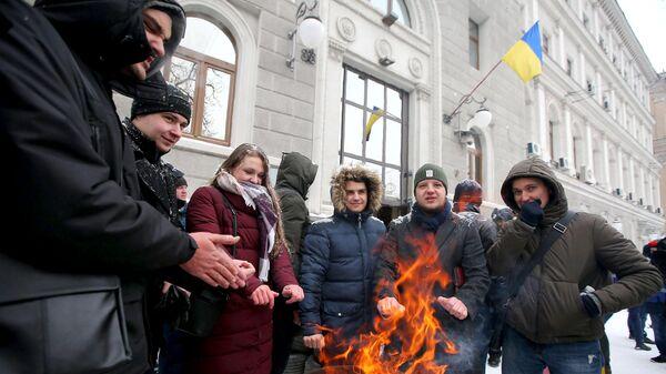 Жители Украины проводят протестную акцию у здания компании Нафтогаз-Украина