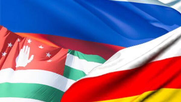 Флаги России, Осетии и Абхазии