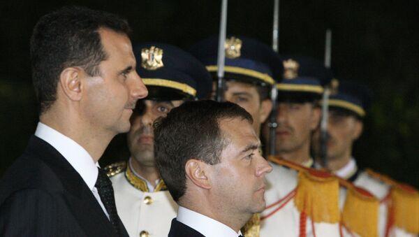 Президент РФ Дмитрий Медведев и президент Сирии Башар Асад (справа налево)