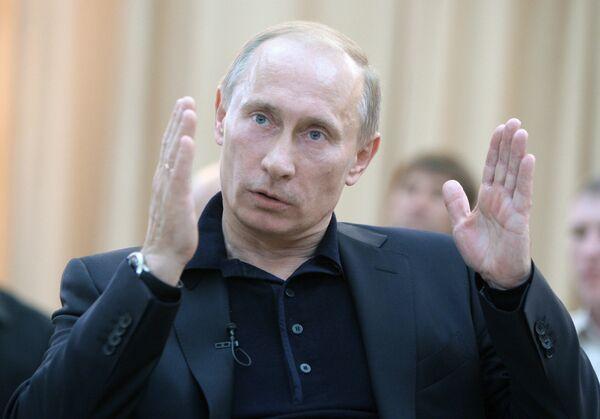 Премьер-министр РФ Владимир Путин побеседовал с шахтерами. Архив