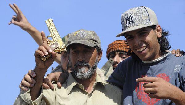Ливийцы празднуют смерть Каддафи