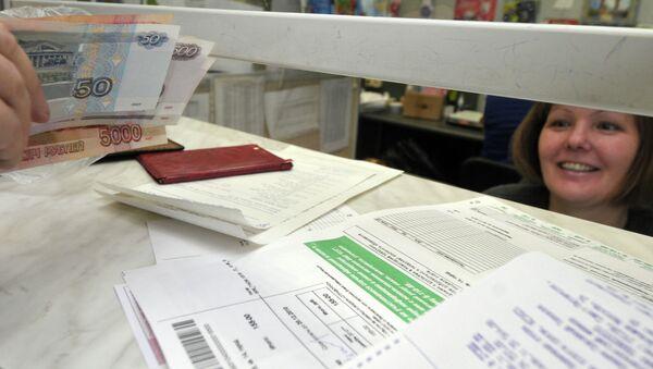 Оплата жилищно-коммунальных услуг. Архивное фото