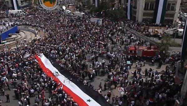 Будущее перемирие в Сирии отмечают стрельбой и митингами