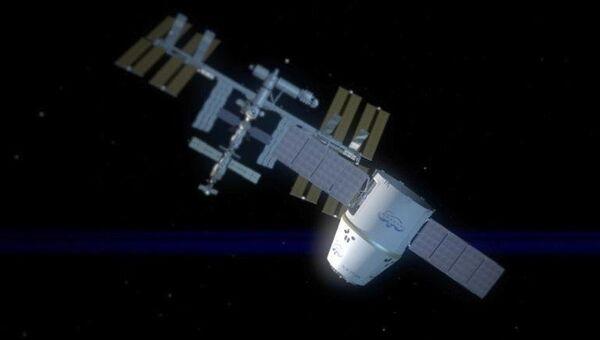 Корабль Dragon пристыкован к МКС