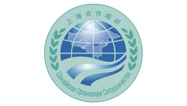 Эмблема Шанхайской организации сотрудничества
