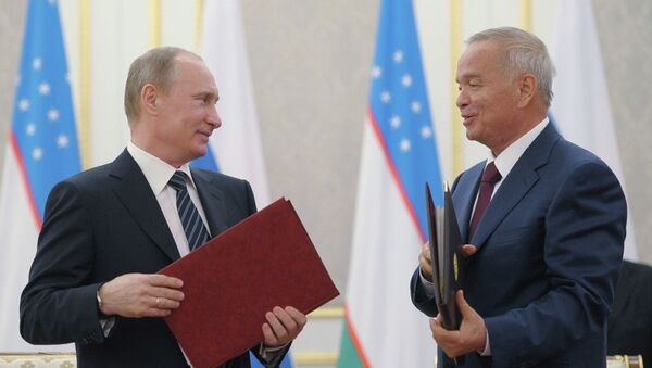 Президент России Владимир Путин (слева) и президент Узбекистана Ислам Каримов. Архив