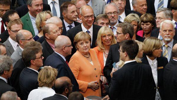 Канцлер Германии Ангела Меркель в бундестаге после голосования по вопросу о помощи Испании