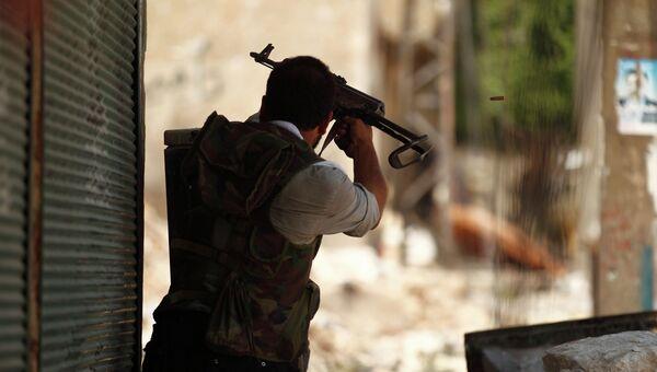 Сирийский солдат в районе Алеппо