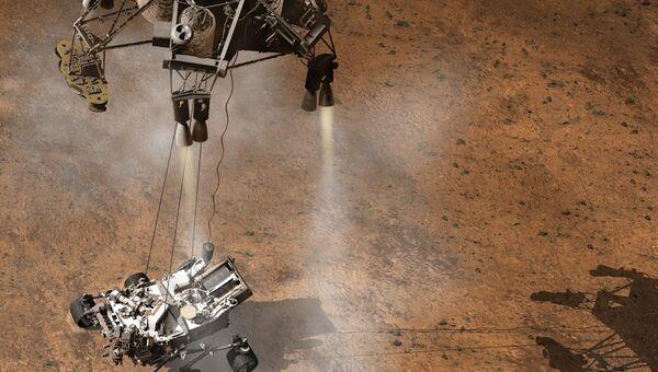 Небесный кран опускает марсоход Curiosity на поверхность Марса