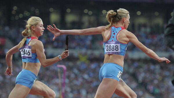 Россиянки Ольга Белкина и Наталья Русакова в эстафете 4 х 100 м