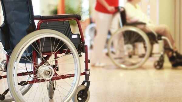 Люди в инвалидных креслах