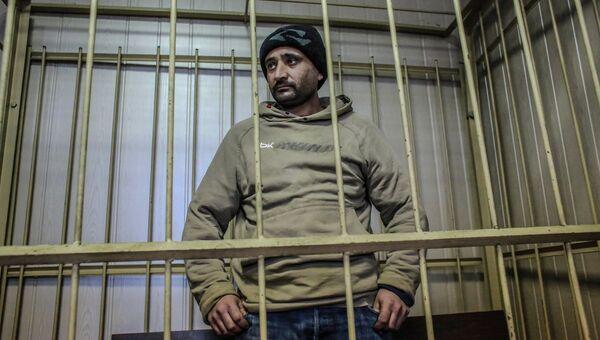 Гражданин Узбекистана Бахром Хурромов, подозреваемый в нанесении повреждений московскому школьнику