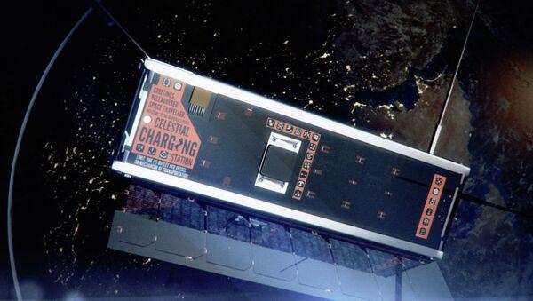 Изображение космического спутника-объекта современного искусства художников Джона Гибсона и Аманды Уайт