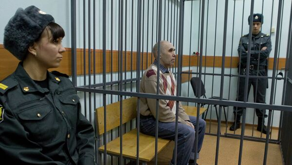 Анатолий Кожевников, обвиняемый в двойном убийстве во время судебного заседания, событийное фото