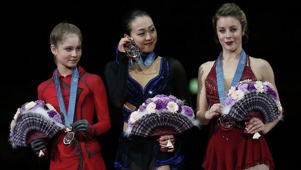 Юлия Липницкая, Мао Асада и Эшли Вагнер (слева направо)
