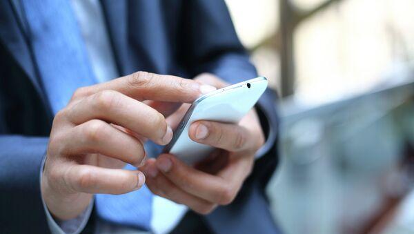 Мобильный телефон, архивное фото