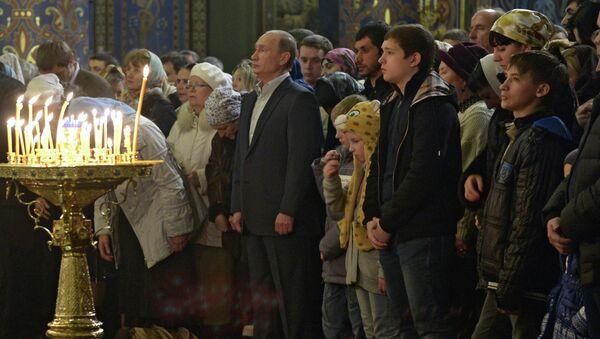 В.Путин посетил Рождественское богослужение. Фото с места события
