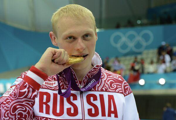 Россиянин Илья Захаров, занявший первое место в прыжках в воду с 3-метрового трамплина
