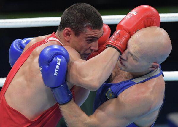 Слева направо: Евгений Тищенко (Россия) и Василий Левит (Казахстан)