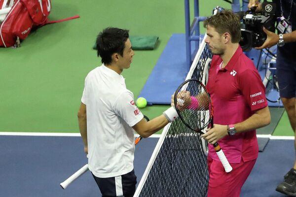Японский теннисист Кэй Нисикори и швейцарец Станислас Вавринка (слева направо)