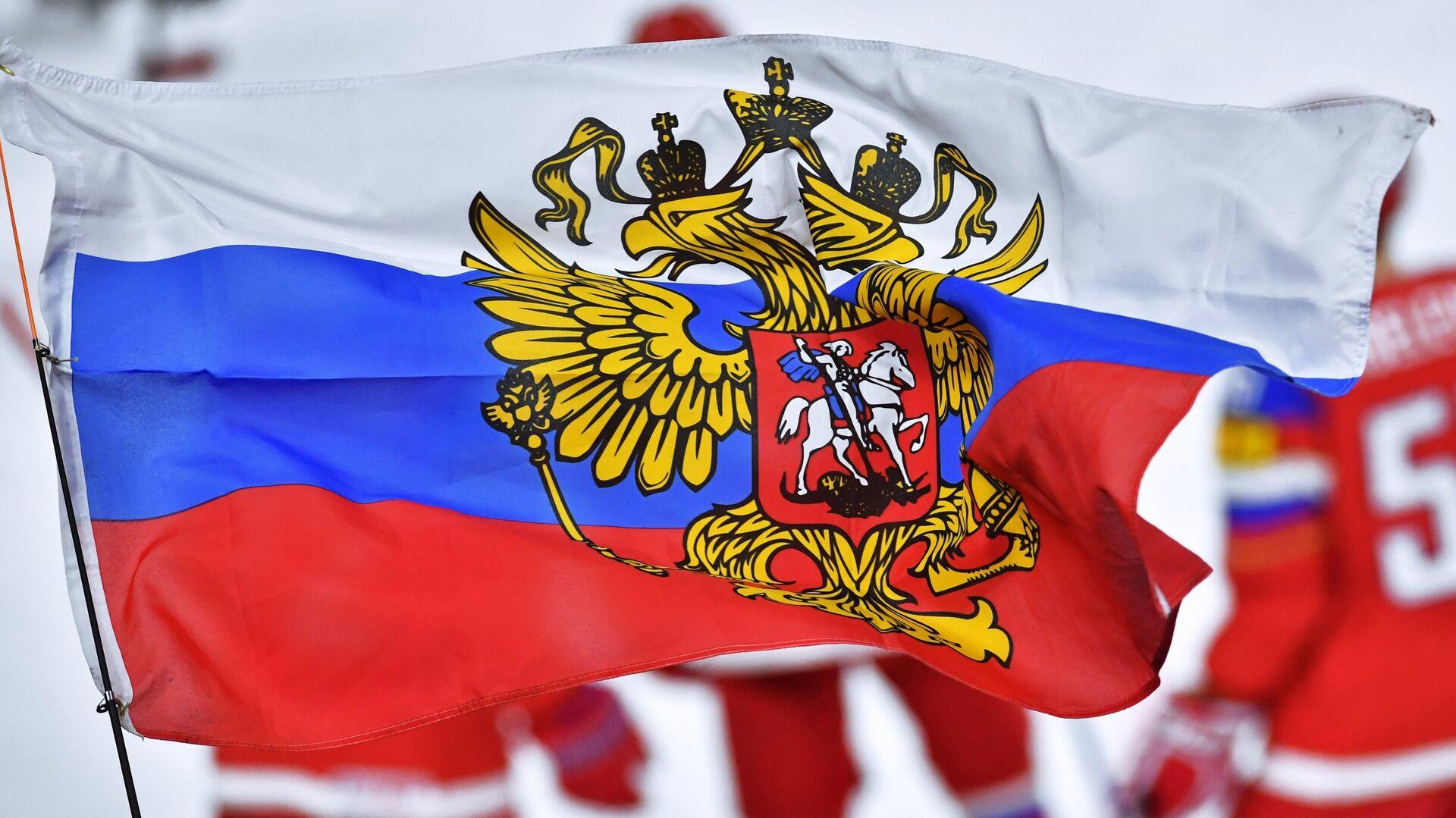 Флаг РФ во время матча российских хоккеистов - РИА Новости, 1920, 21.09.2021