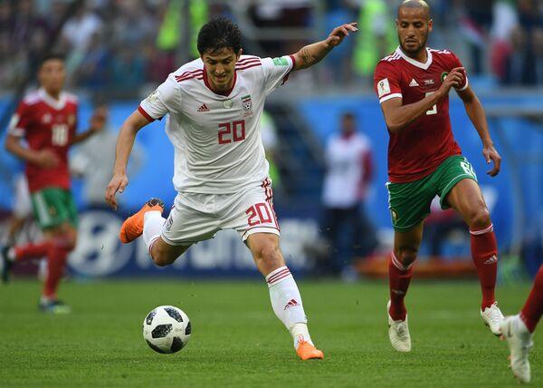 Слева направо: Сердар Азмун (Иран) и Карим аль-Ахмади (Марокко)