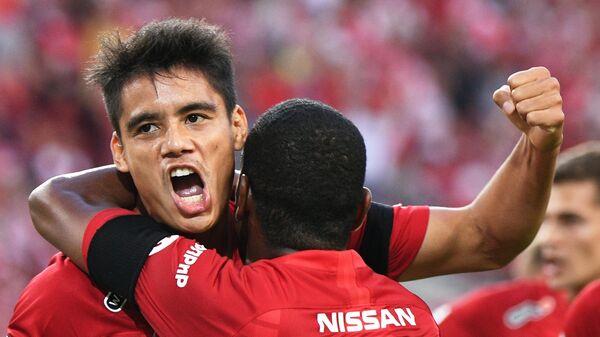 Игроки Спартака Лоренсо Мельгарехо (слева) и Фернандо радуются голу в ворота Динамо