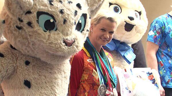Олимпийские чемпионы России первыми примерили новую форму Сочи-2014
