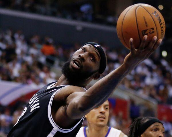 Баскетболист Бруклина Регги Эванс